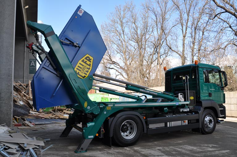 Skip handler AK12 at waste deposit