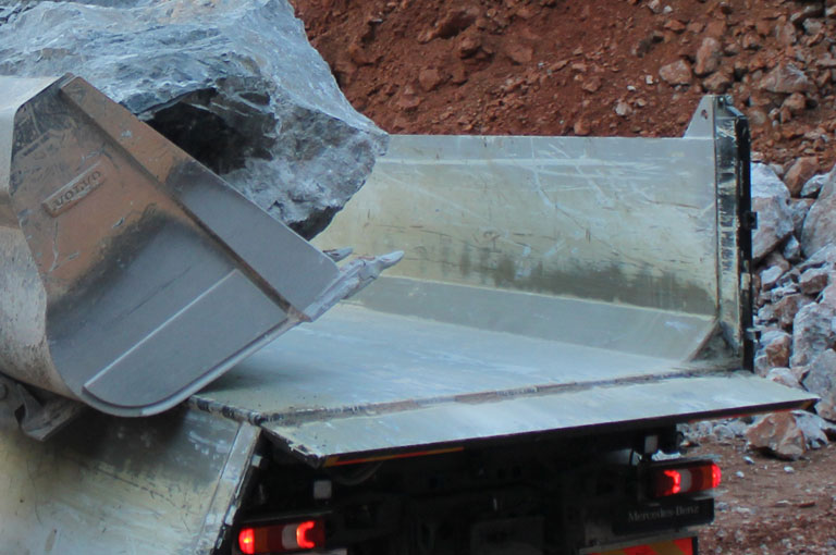 Loading rock tipper