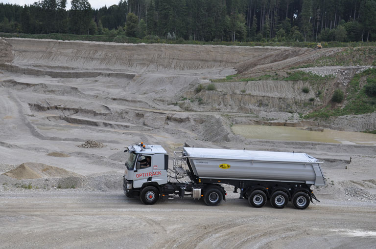 Tipping semi-trailer in gravel-pit